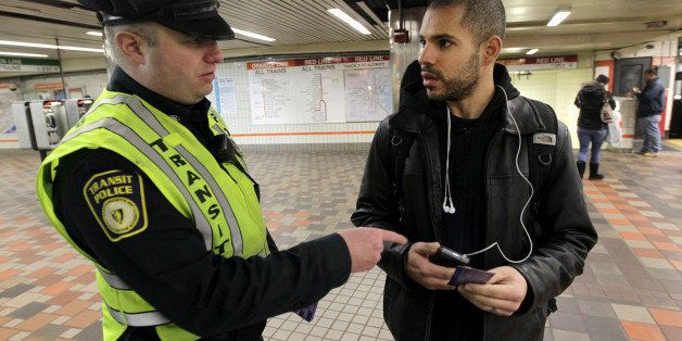 BOSTON - JANUARY 23: Transit police officer Nick Morrissey advises Luis Tejeda concerning theft of phones at the Downtown Cro