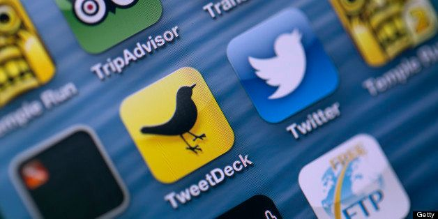 Logos for Twitter Inc.'s TweetDeck app, center left, and Twitter app, center right, are seen on the screen of an Apple Inc. i