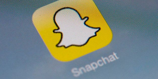The logo of mobile app 'Snapchat' is displayed on a tablet on January 2, 2014 in Paris. Hackers broke into Snapchat, the huge