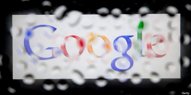 The Google Inc. logo is seen through water droplets for an arranged photograph in Washington, D.C., U.S., on Monday, Oct. 15,