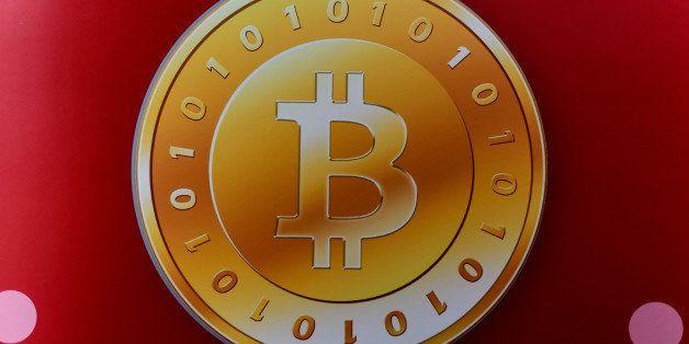 A bitcoin logo is seen during the opening ceremony of the first bitcoin retail shop in Hong Kong on February 28, 2014. Bitcoi