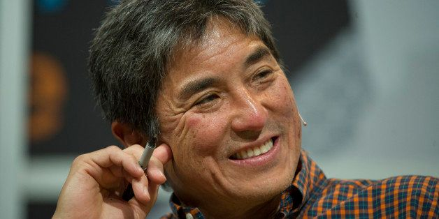 Guy Kawasaki, chairman and chief executive officer of Garage.com, listens as Mark Cuban, billionaire owner of the NBA Dallas