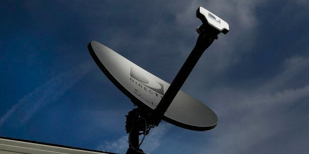 A DirecTV satellite dish stands on the roof of a home in Compton, California, U.S., on Monday, May 5, 2014. DirecTV beat anal
