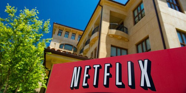 The Netflix Inc. logo is displayed at the entrance to the company's headquarters in Los Gatos, California, U.S., on Thursday,