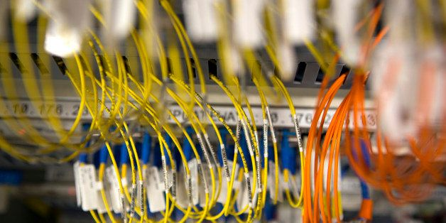 Fiber optic cables are connected to a server at Telefonos de Mexico SAB (Telmex) headquarters in Mexico City, Mexico, on Satu