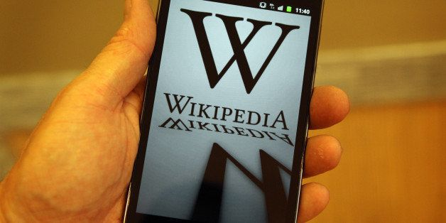 LONDON, ENGLAND - JANUARY 18:  A mobile device shows Wikipedia's front page displaying a darkened logo on January 18, 2012 in