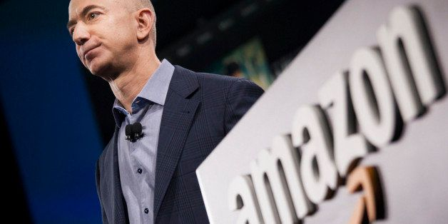 SEATTLE, WA - JUNE 18: Amazon.com founder and CEO Jeff Bezos presents the company's first smartphone, the Fire Phone, on June