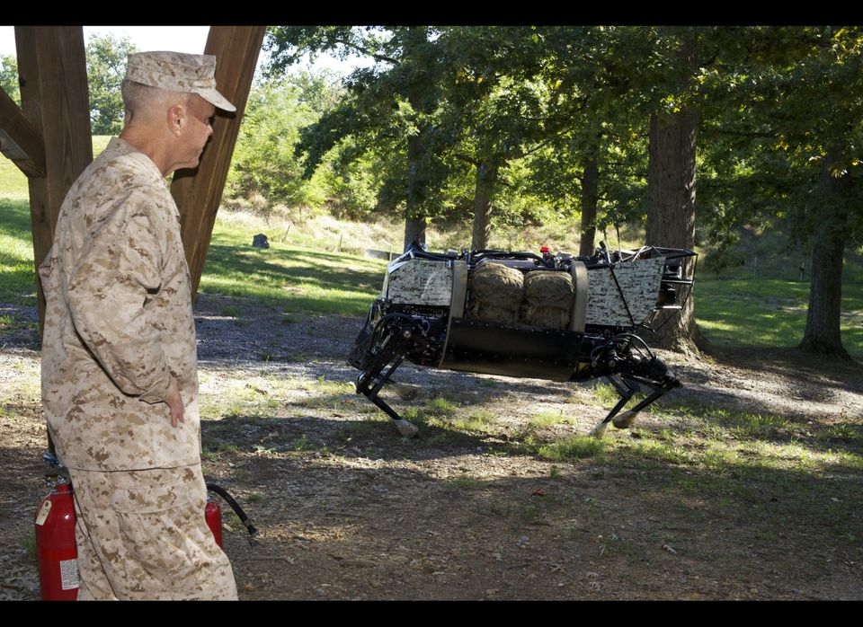 U.S. Marine Corps Gen. James F. Amos, the commandant of the Marine Corps, watches a demonstration of a legged squad support s