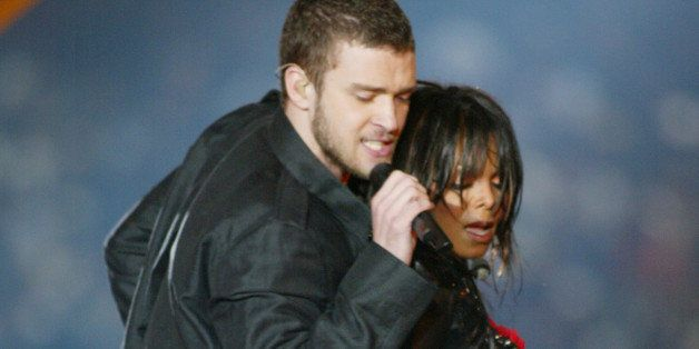 Justin Timberlake and Janet Jackson perform during the half - time show at Super Bowl XXXVIII (Photo by J. Shearer/WireImage)