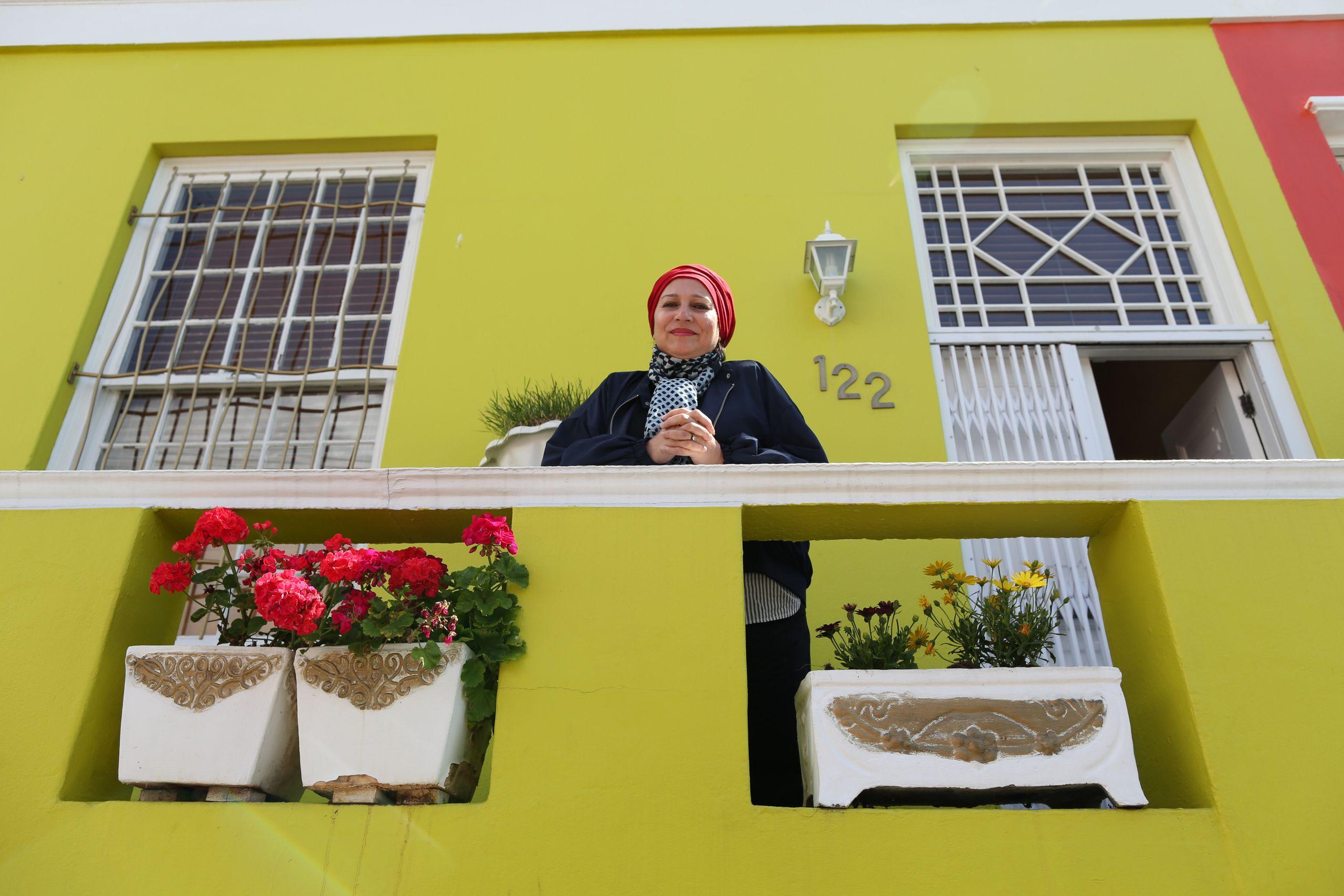 Rashida Emeran poses for a photo outside her house in Bo-Kaap.<i></i>