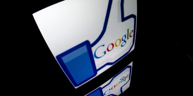 The 'Google' logo is seen on a tablet screen on December 4, 2012 in Paris. AFP PHOTO / LIONEL BONAVENTURE        (Photo credi