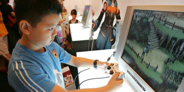 SHANGHAI, CHINA - JUNE 30: (CHINA OUT)  A young boy plays Sony's Playstation 2 video game system at the 2005 Shanghai Animati