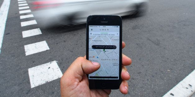 BARCELONA, SPAIN - JULY 01:  In this photo illustration the new smart phone taxi app 'Uber' shows how to select a pick up loc