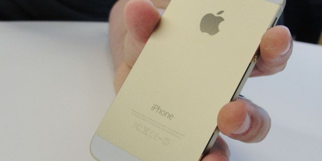 New iPhone 5S will come in a gold color as well as 'space gray.' shows at an iPhone event at Apple's headquarters in Silicon