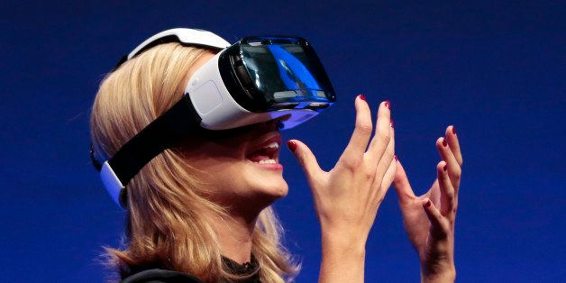 British television presenter Rachel Riley shows a virtual-reality headset called Gear VR during an unpacked event of Samsung