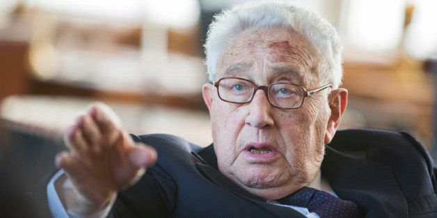 Former US Secretary of State Henry Kissinger gestures during a birthday reception for Kissinger's 90th birthday in Berlin, on