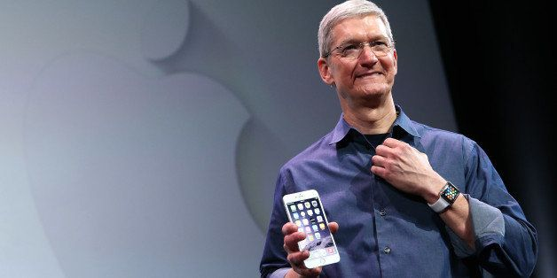 CUPERTINO, CA - SEPTEMBER 09:  Apple CEO Tim Cook shows off the new iPhone 6 and the Apple Watch during an Apple special even