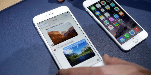 The iPhone 6 plus, left, and iPhone 6 are displayed on Tuesday, Sept. 9, 2014, in Cupertino, Calif. (AP Photo/Marcio Jose San