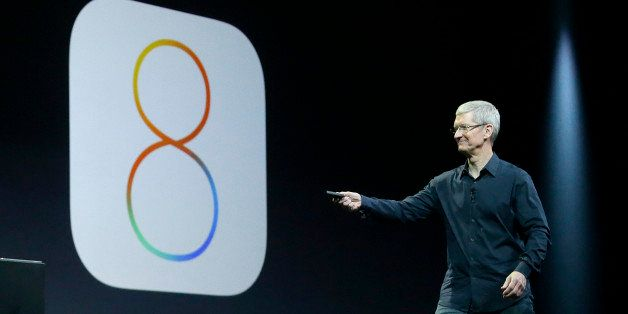Apple CEO Tim Cook speaks about iOS 8 at the Apple Worldwide Developers Conference in San Francisco, Monday, June 2, 2014. (A