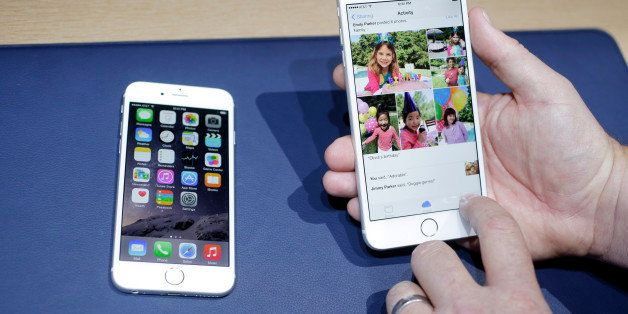 FILE - This Sept. 9, 2014 file photo shows the iPhone 6, at left, and iPhone 6 plus during a new product release in Cupertino