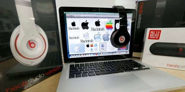 Beats Audio equipment is arranged for a photo next to an Apple laptop at Best Buy in Boston, Friday, May 9, 2014. Apple is or
