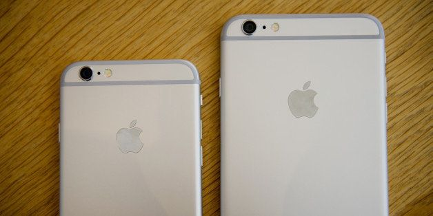 An Apple Inc. iPhone 6, left, and iPhone 6 Plus are arranged for a photograph during the sales launch at an Apple store in Pa