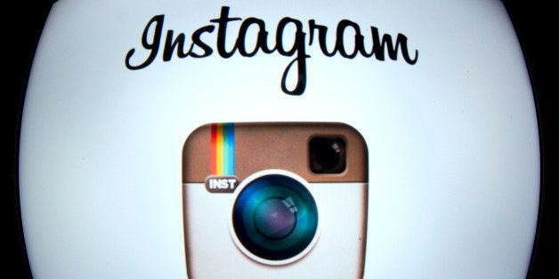 The Instagram logo is displayed on a tablet on December 20, 2012 in Paris. Instagram backed down on December 18, 2012 from a