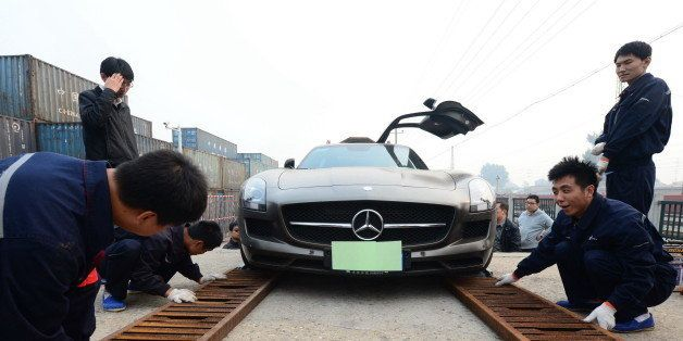 BEIJING, CHINA - OCTOBER 08: (CHINA OUT) First patch of self-driving travel autos carried by a special train arrives in Beijing on October 8, 2014 in Beijing, China. A train carrying 50 self-driving travel autos arrives in beijing from Hangzhou, which brings convenicence for people who choose self-driving travel. (Photo by ChinaFotoPress/ChinaFotoPress via Getty Images)