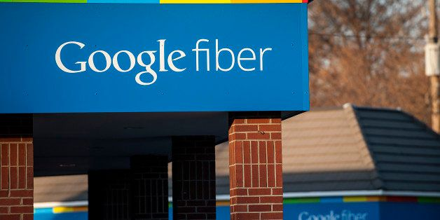 Google Inc. Fiber signage is displayed outside of the company's office in Kansas City, Missouri, U.S., on Tuesday, Nov. 27, 2