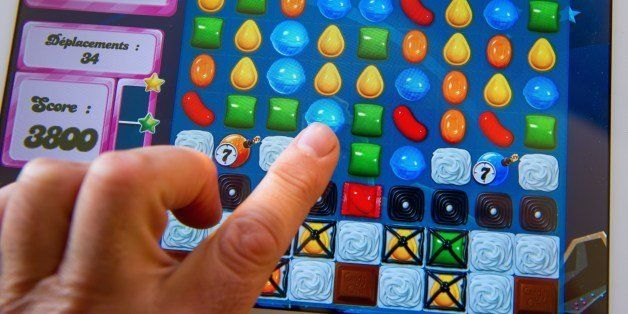 A person plays on his tablet with Candy Crush Saga games developed by British King Digital Entertainment, on March 6, 2014, i