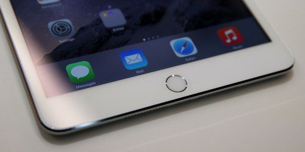 CUPERTINO, CA - OCTOBER 16:  A touch I.D. pad is seen on the new iPad Mini 3 during an Apple special event on October 16, 201