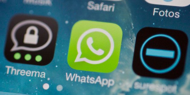 BERLIN, GERMANY - FEBRUARY 24: The icons of the messenger apps Whatsapp, Surespot and Threema on a display of a cellphone on