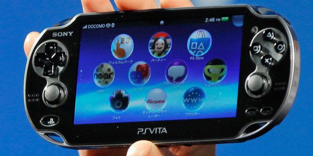 """Sony Computer Entertainment's PlayStation Vita, called """"PSVITA"""" for short, is shown during a press conference in Tokyo Wednes"""