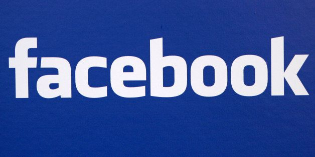 FILE - In this Nov. 6, 2007 file photo, the Facebook logo is displayed at a Facebook announcement in New York. A report in th