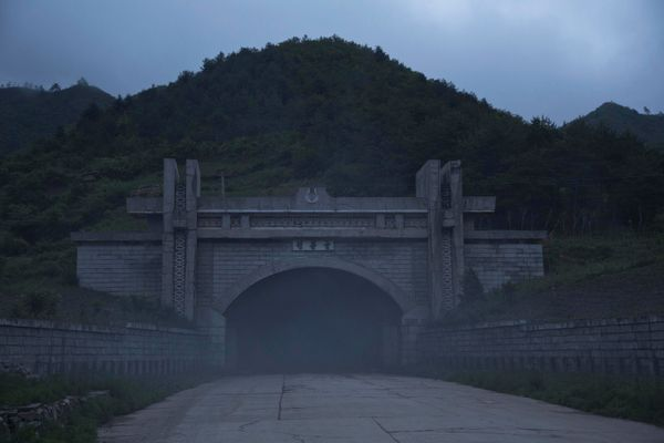In this June 20, 2014 photo, exhaust fumes, like fog, spills out of the long Hamgwan Tunnel near Hamhung in North Korea's Sou