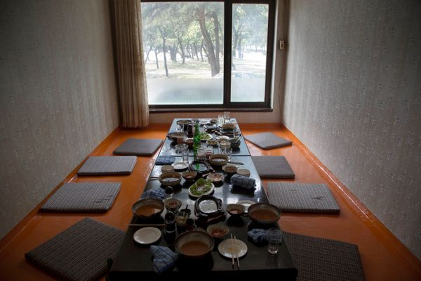 In this June 15, 2014 photo, the remains of lunch sits on a restaurant table in the city of Wonsan, North Korea. (AP Photo/Da