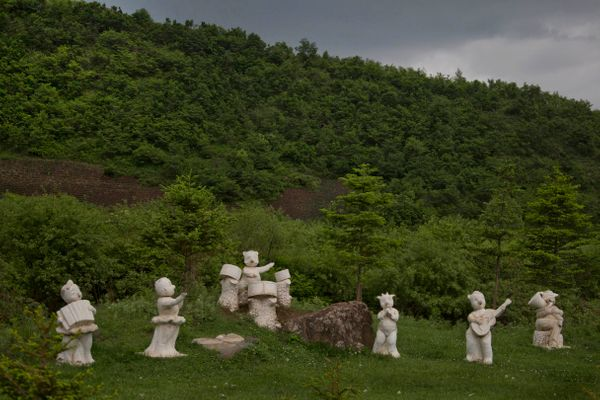 In this June 16, 2014 photo, statues of animals playing musical instruments stand along the roadside south of Samsu, North Ko