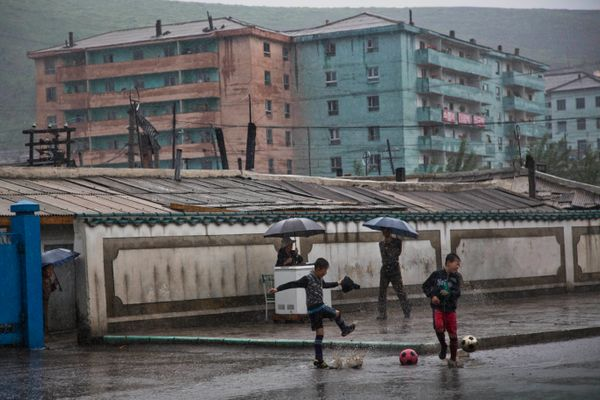 In this June 16, 2014 photo, boys play soccer in the town of Hyesan in North Korea's Ryanggang province. (AP Photo/David Gutt