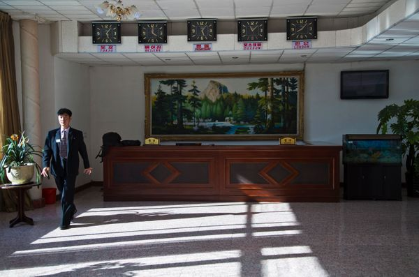 In this June 19, 2014 photo, a hotel employee walks in the lobby of a hotel that accommodates foreign visitors in Chongjin, N