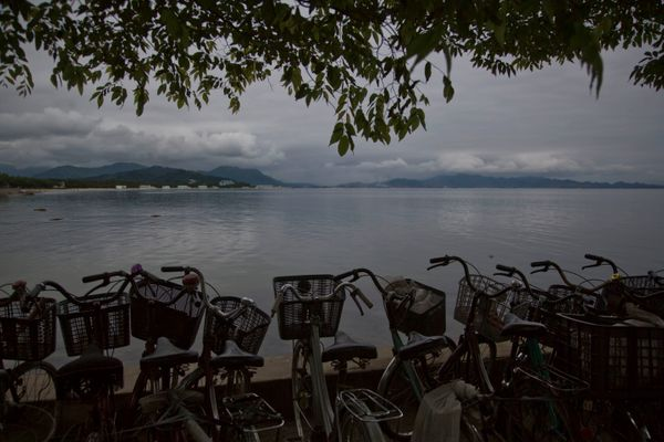 In this June 21, 2014 photo, a row of bicycles are parked next to the sea Wonsan, North Korea. (AP Photo/David Guttenfelder)