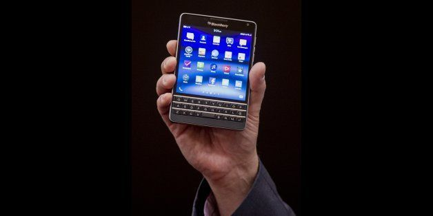Ron Louks, president of devices at BlackBerry Ltd., displays the Classic mobile device while speaking at a press conference d