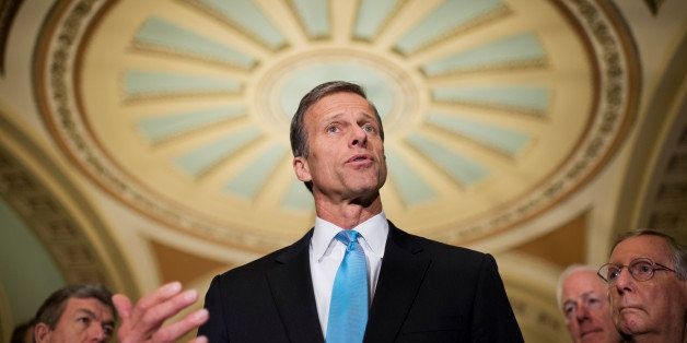 UNITED STATES - FEBRUARY 25: Sen. John Thune, R-S.D., talks with the media after the senate luncheons in the Capitol. Sens. R