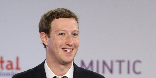 Facebook founder and CEO Mark Zuckerberg smiles during an event to launch in Colombia an app providing free basic Internet se