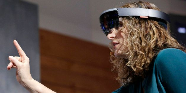In this Jan. 21, 2015 photo, Microsoft's Lorraine Bardeen demonstrates HoloLens headset during an event at the company's head