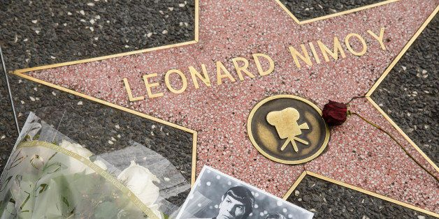 HOLLYWOOD - CA - FEBRUARY 27, 2015: Flowers and a photo are placed at Leonard Nimoy's star on the Walk of Fame on 6651Hollywo