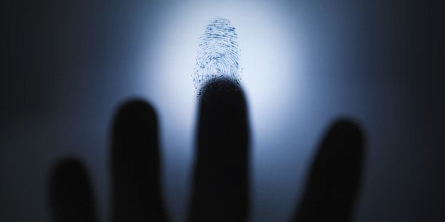 Blurred hand hovering over fingerprint