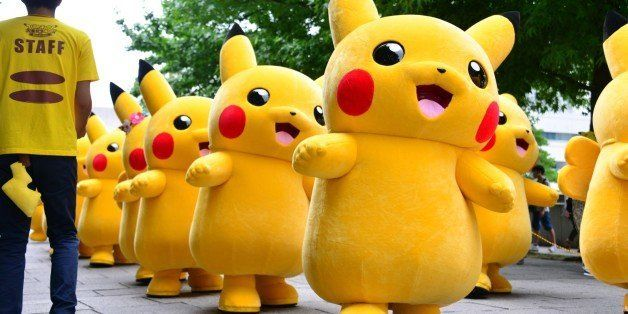 Dozens of Pikachu characters, the famous character of Nintendo's videogame software Pokemon, parade at the Landmark Plaza sho