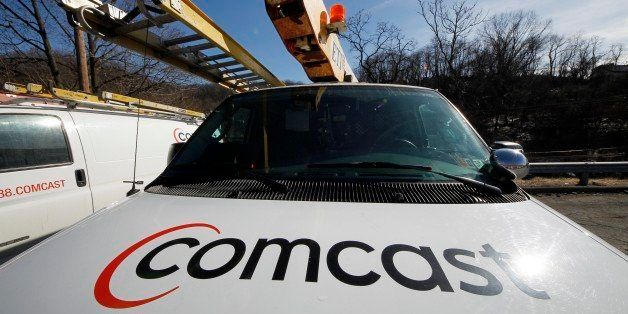 A Comcast logo is seen on a Comcast truck in Pittsburgh Tuesday, Feb. 15, 2011.  (AP Photo/Gene J. Puskar)