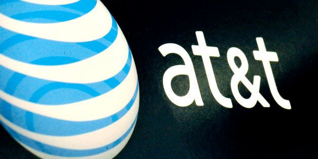 FILE - In this Oct. 19, 2009 file photo, the AT&T logo is on display at a RadioShack store in Gloucester, Mass. AT&T