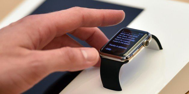 A customer plays with a new Apple Watch in an Apple store in Sydney on April 10, 2015. Apple started taking orders from customers before the sale of the watch which will be available to buy in Australia on April 24, 2015. AFP PHOTO / Peter PARKS (Photo credit should read PETER PARKS/AFP/Getty Images)